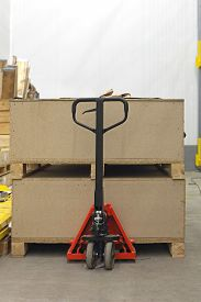 image of jack-in-the-box  - Pallet Jack With Big Wooden Crates Boxes - JPG