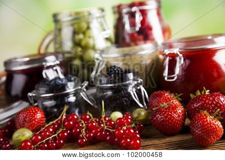 Set of glass jars with fruits jam