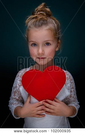 child cute daughter holding heart sign