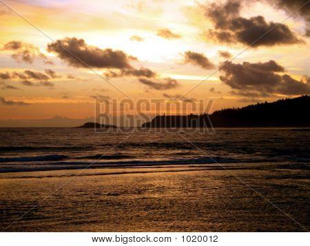 Sunrise Over Lighthouse On Peninsula