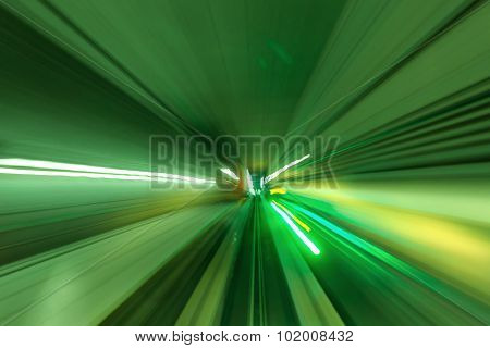 high speed movement in a tunnel in green light