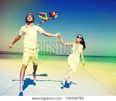 Couple Beach Kite Flying Getaway Holiday Concept