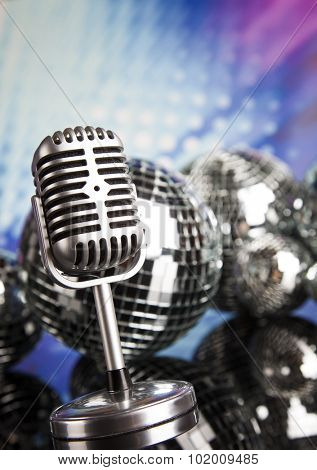Retro style microphone on sound waves and Disco Balls