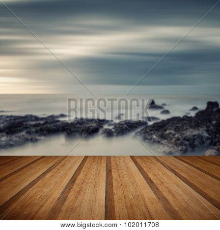 Vintage Style Cross Processed Seascape Long Exposure With Wooden Planks Floor