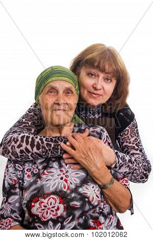 Old Mother And The Adult Daughter In Love To Care, Having Embraced
