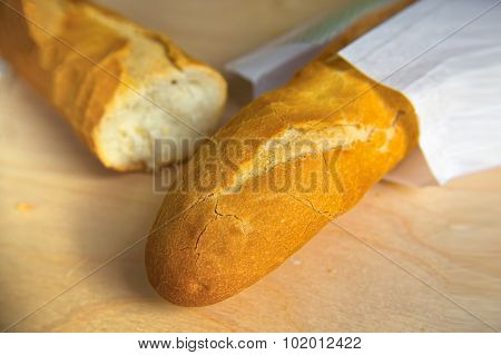 Long Loaf French Baguette On Wooden Table