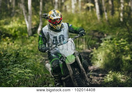 rider overcomes mud puddle