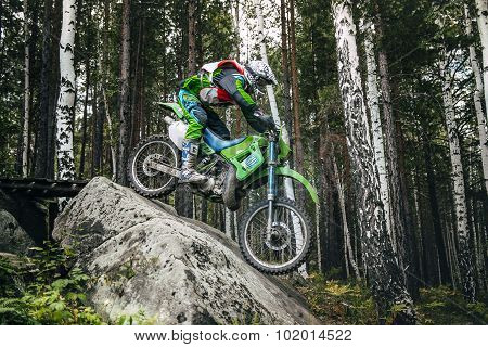 Enduro racer down with a large stone