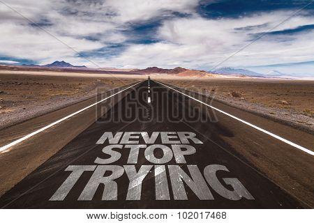 Never Stop Trying written on desert road