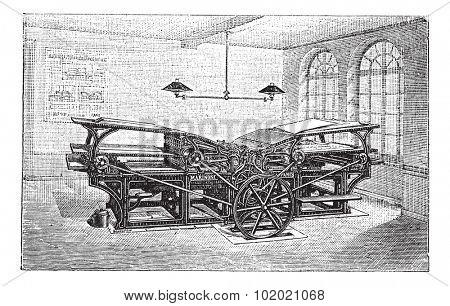 Marinoni double printing press, vintage engraving. Old engraved illustration of Marinoni double printing press in the factory.   Trousset encyclopedia (1886 - 1891).