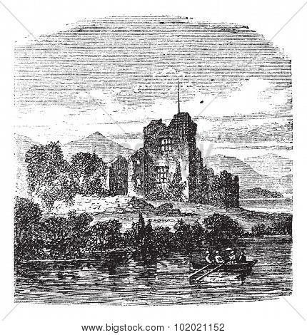 Ruins of Castle Ross, Killarney, Ireland vintage engraving. Old engraved illustration of medieval Ross castle Killarney, Ireland, 1800s. Trousset encyclopedia (1886 - 1891).