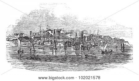 Gallipoli or Gelibolu in Turkey, during the 1890s, vintage engraving.  Old engraved illustration of Gallipoli with moving boats in front and city in back. Trousset encyclopedia (1886 - 1891).