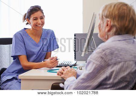 Senior Patient Having Consultation With Nurse In Office