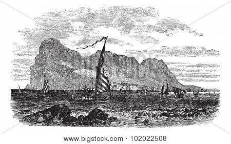Gibraltar in Iberian Peninsula, Europe, during the 1890s, vintage engraving. Old engraved illustration of Gibraltar with moving boats in front. Trousset encyclopedia (1886 - 1891).