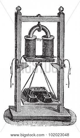 Electro-magnet weight load, vintage engraved illustration. Trousset encyclopedia (1886 - 1891).