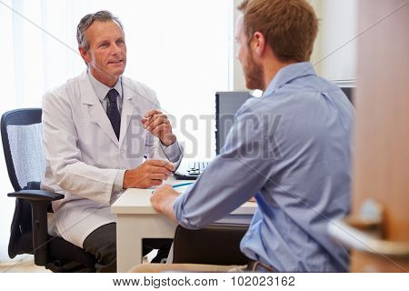 Male Patient Having Consultation With Doctor In Office