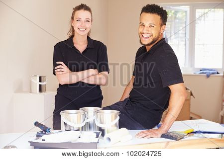 Portrait of smiling male and female decorators