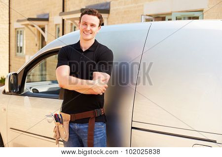 Portrait of a young tradesman by his van