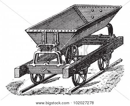 Old engraved illustration of the dumper box fitted with metal sheet and double hinged switch uses for the transportation of concrete. Industrial encyclopedia E.-O. Lami - 1875.