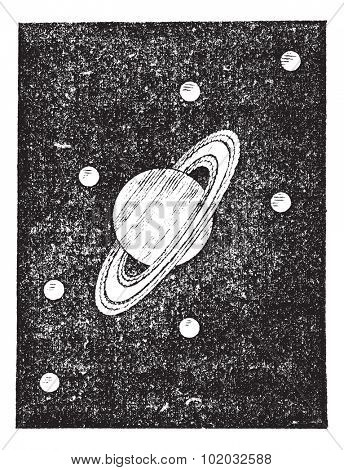 Old engraved illustration of Saturn and its satellites. Dictionary of words and things - Larive and Fleury - 1895