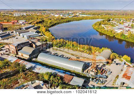 Transportation company on river bank. Tyumen. Russia