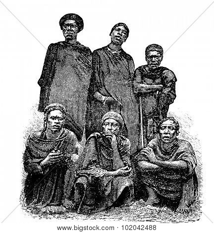 Mandombe Men of Congo, Central Africa, engraving based on the English edition, vintage illustration. Le Tour du Monde, Travel Journal, 1881
