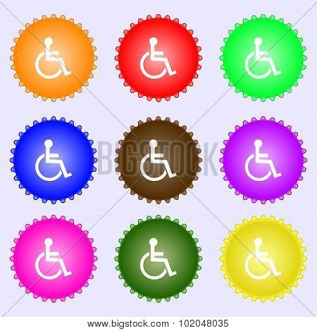 Disabled Sign Icon. Human On Wheelchair Symbol. Handicapped Invalid Sign. A Set Of Nine Different Co