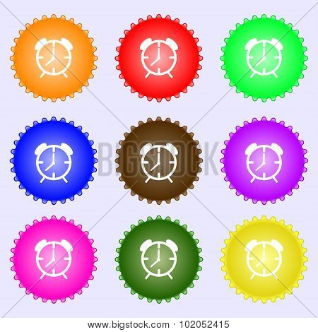 Alarm Clock Sign Icon. Wake Up Alarm Symbol. A Set Of Nine Different Colored Labels. Vector