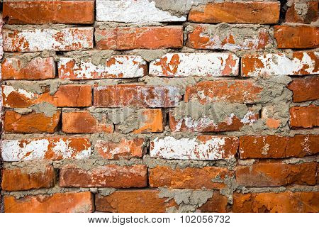 Red brick wall closeup with sparse white bricks, old obsolete texture red brick wall background