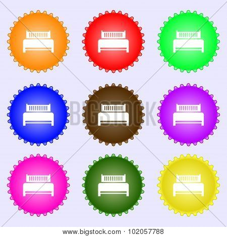 Hotel, Bed Icon Sign. A Set Of Nine Different Colored Labels. Vector