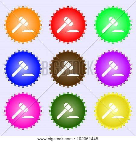Judge Hammer Icon. A Set Of Nine Different Colored Labels. Vector