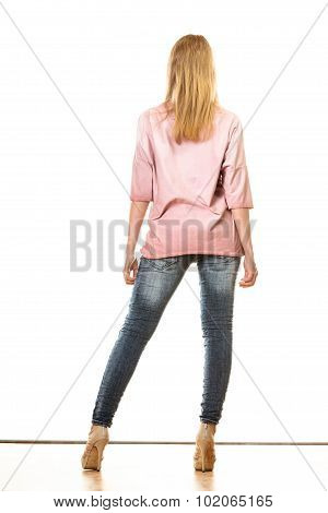 Woman In Denim Pants High Heels Shoes Back View