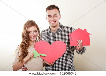 Couple With Paper House And Heart Love Symbol.