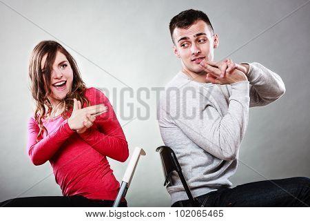 Couple Having Fun Pretend Hands Fingers Are Guns.