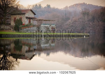 Stone Cottage On Lake, Brown Colors, Peaceful Atmosphere