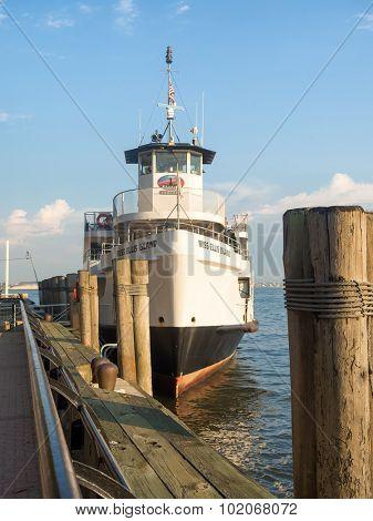 NEW YORK,USA - AUGUST 16,2015 : Statue of liberty tourist cruise ship at  Ellis Island