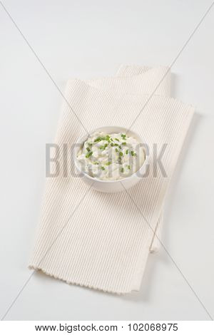 bowl of chives spread on white place mat