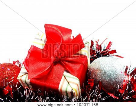 Gift Box Present With Red Ribbon Decorations With Red And White Tinsel Chistmas Background