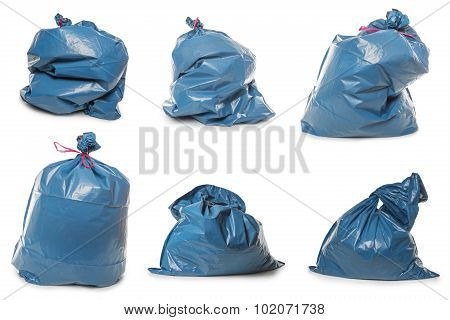 Collection Of Blue Rubbish Bags On White