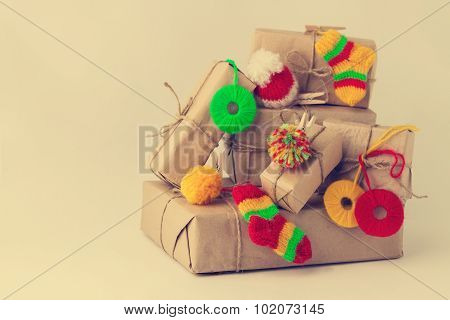 Vintage Handmade Gifts Boxes With Small Knitted Christmas Decorations Isolated On White Background.