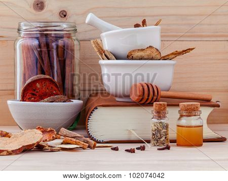 Alternative Medicinal Chinese Herbal Medicine  For Healthy Recipe With Dry Herbs  And Mortar On Wood