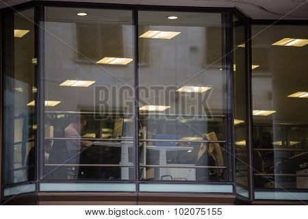 Business people having a meeting. View through the window, London
