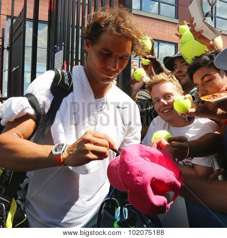 Fourteen times Grand Slam champion Rafael Nadal of Spain signing autographs after practice for US Op