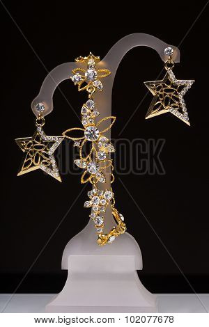 gold pendant and earrings in the form of stars
