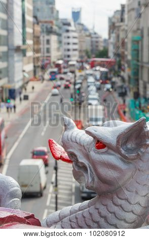 Holborn dragon close up and blurred view on the London road with ca