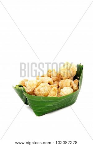 Thai Food Appetizer ,pork Snack, Pork Rind, Pork Scratching, Pork Crackling In Banana Leaf Bowl.