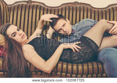 vintage couple lying on the retro furniture