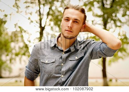 Portrait Of A Pensive Young Man With A Beard