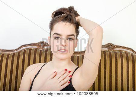 Sexy Person  Indoor Lifts Up Hair, Looking Seductive At Camera