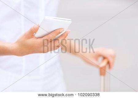 Stylish woman holding suitcase